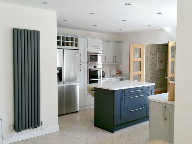 light grey shaker kitchen cabinets with charcoal island